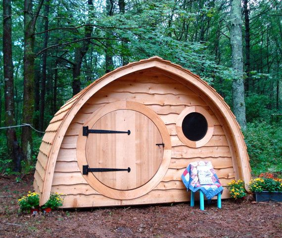 Hobbit Hole Playhouse Kit: outdoor wooden kids playhouse with round front door and windows, made to order on Etsy, $1,595.00