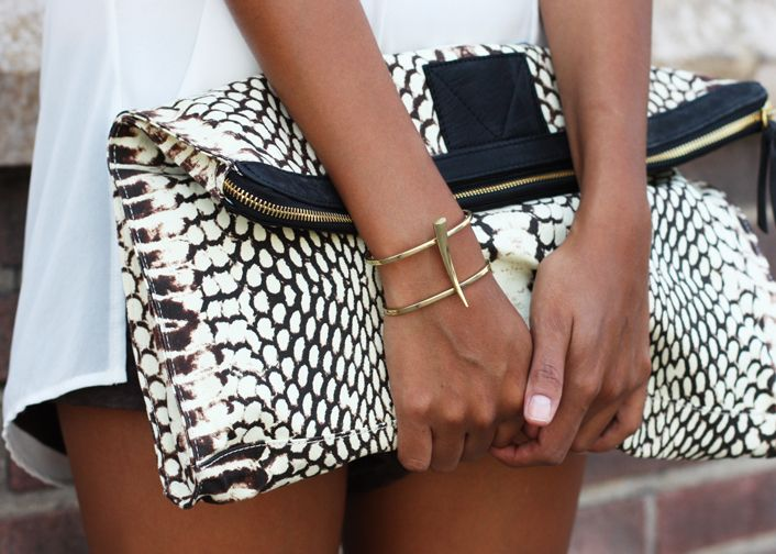 Black and white clutch with gold jewelry. #accessories #fashion