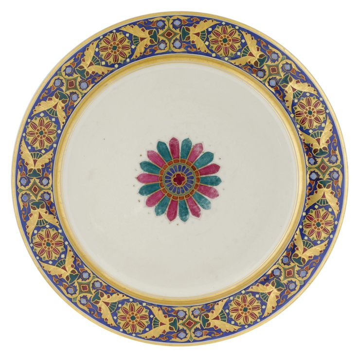 A porcelain charger from the Gothic Service, Russian Imperial Porcelain Manufactory, period of Nicholas I, (1825-1855), the cavetto painted with a vari-coloured rosette, the border with tracery on a cobalt blue ground, with blue Imperial cipher of Nicholas I. Estimate   8,202 - 11,482USD