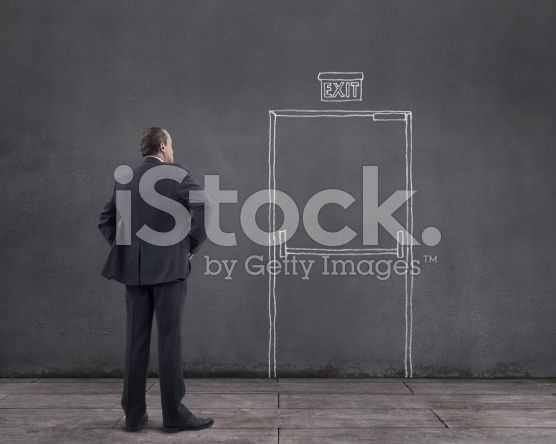 Businessman and Emergency Exit Door (royalty-free stock photo) © mgkaya