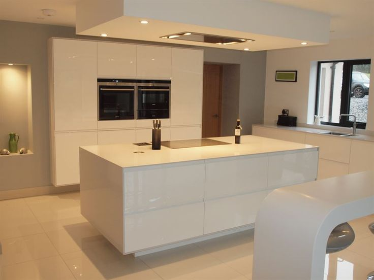 ATLANTIS KITCHENS PROJECT: Handleless Gloss White Kitchen - 12mm Silestone worktops - Siemens appliances - Quooker boiling water tap - Bespoke curved corian breakfast bar