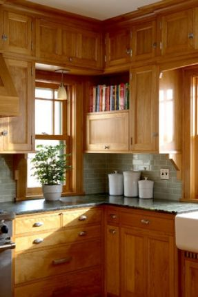 Prairie School kitchen with red birch cabinets and grey subway tile backsplash - David Heide Design