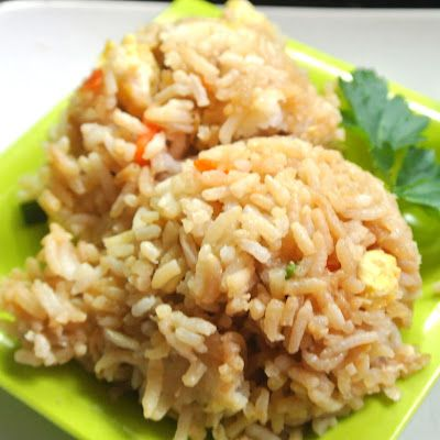 Benihana's Fried Rice 1/4 cup chopped sweet onion 1/4 cup chopped carrots 1 TBSP chopped green onions 2 cups cooked rice 1 tsp salt 2 TBSP butter 4 eggs 2 tsp canola oil 1 chicken breast, cooked 1 teaspoon sesame seeds 1/2 tsp  pepper 1/4 cup braggs amino acids or gluten free soy sauce
