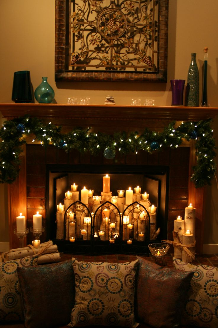 "I had an unused fireplace and searched for an inspiration to make it the focal point of the space.  This is my completed ""Candle Fireplace"" and I just love the ambience it gives to my living room."