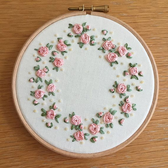 This piece is a hand-stitched ribbon embroidery, made with silk ribbon and natural cotton. Ive stitched these little roses and buds in a wreath