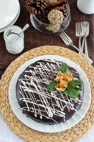 Rich Flourless Paleo Chocolate Cake. The only sweetener is some dates and it is full of healthy fats from coconut and avocado. Really great for a treat! Happy cooking :]