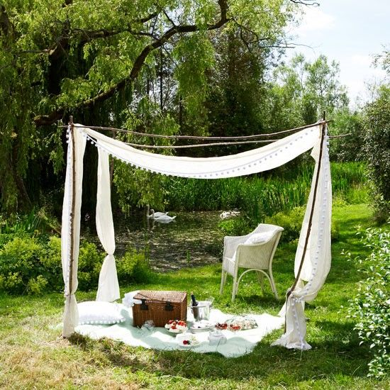 White garden canopy - Airy voiles, reminiscent of Edwardian parasols, and stripped birch poles make a pretty sunshelter.