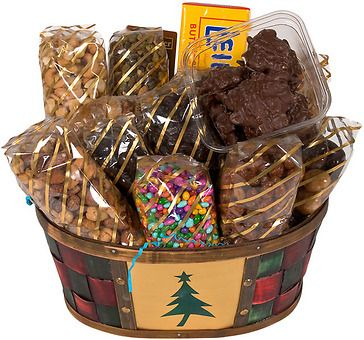 This cheerful Christmas basket is overflowing with nearly 8 pounds of yummy treats to bring a big smile to its lucky recipient.