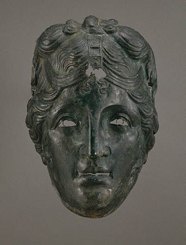 Ancient Roman,Woman's Parade Mask from a Cavalry Helmet. Getty Museum. 75-125 A.D. Bronze 11 x 7 in.