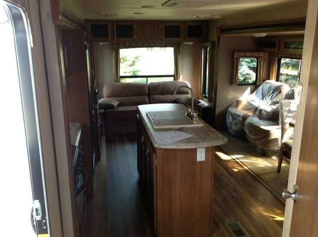 2016 New Coachmen 293 RLDS Catalina Travel Trailer in Michigan MI.Recreational Vehicle, rv, 2016 Coachmen 293 RLDS Catalina Rear Living Room w/ 2 slideouts WOW!!!!What a trailer!! Large living room! sofa,2 swivel chairs,Power Awning, power tongue jack, multi media sound system w/DVD and CD radio, outside shower, outside speakers,2-30lb propane tanks w/cover, enclosed heated under belly, stainless steel microwave, double door refrigerator 3-burner range w/oven, swing arm bracket for TV…