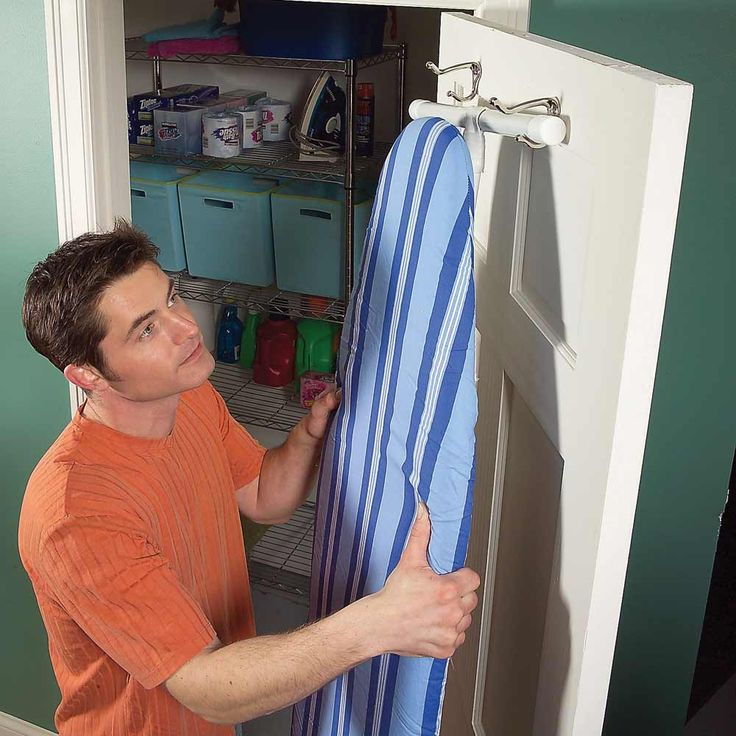 Ironing Board Storage. Ordinary coat hooks on the back of a closet door keep your ironing board out of the way but close at hand when you need it.