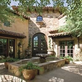 Entry courtyard with fountain at a Mediterranean style home