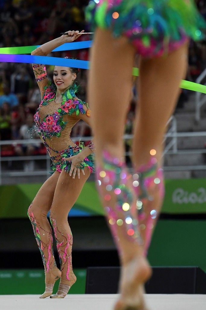 Russia's team compete in the group all-around qualifying event of the Rhythmic Gymnastics at the Olympic Arena during the Rio 2016 Olympic Games in Rio de Janeiro on August 20, 2016. / AFP / Ben STANSALL