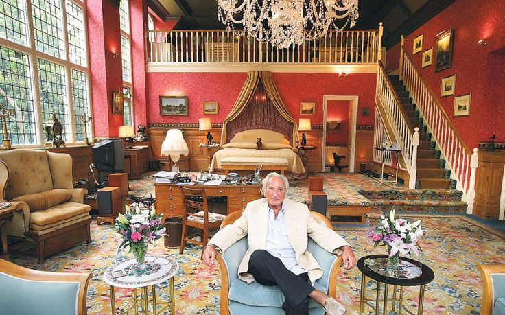 """Michael Winner's mansion in Kensington, London boasted no less than 47 rooms. Here he is, pictured in his bedroom, which King Edward VII once described as """"one of the finest rooms in London""""."""
