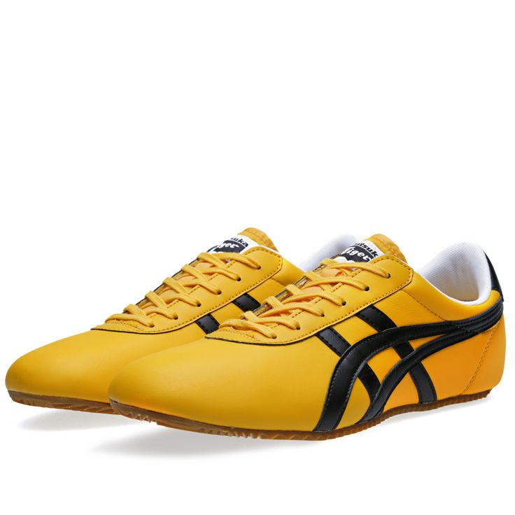 Simplicity and refinement are the main forces at play in the design of the Tai Chi, from Japanese sneaker masters Onitsuka Tiger. Its leather upper sits on top of a low profile rubber sole, finished with the classic stripe design, printed logo on the heel and stitched logo tab on the tongue.   Leather Upper Classic Onitsuka Tiger Stripes Low Profile Sole Printed logo on Heel Stitched Logo Patch on Tongue