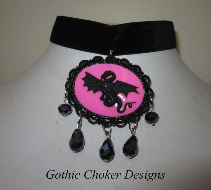 Black velvet choker with pink dragon cameo and black glass crystals. R140 approx $14.  Purchase here: https://hellopretty.co.za/gothic-choker-designs/black-choker-with-pink-dragon-cameo-and-black-crystals