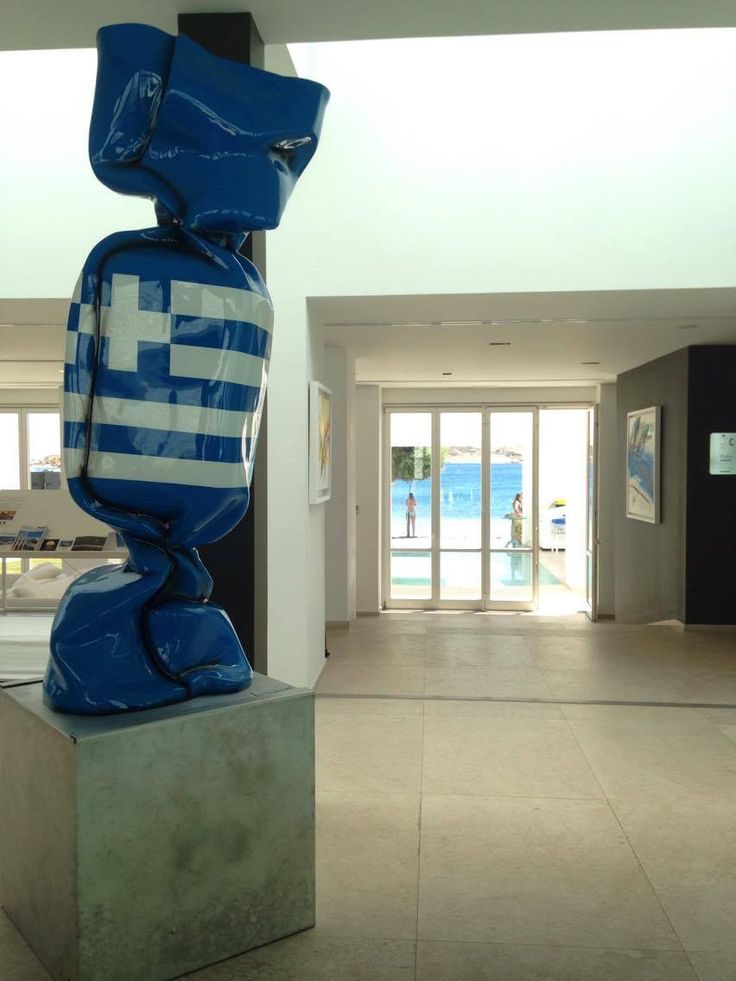 Laurence Jenkell famous wrapping flag Greece work of art in Patmos Aktis Suites & Spa!