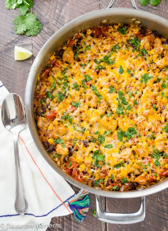 30-Minute Cheesy Mexican Rice Skillet is an easy one pot meal with chicken, rice, and plenty of Mexican spice!