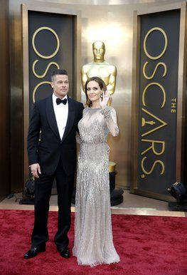 Brad Pitt and Angelina Jolie, who is wearing an Elie Saab gown.