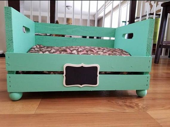 This personalized wooden crate dog bed will give your small pet a stylish place to rest. Dimensions: L= 18 inches W= 13 inches H= 11 inches It comes with a chalkboard slate that you can erase and change anytime. I will reimburse you for the actual shipping cost! Please message me before