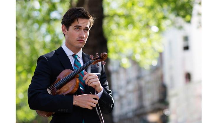 A dapper violinist, Charlie Siem.