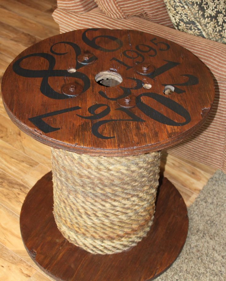 My version of a spool table!   7 dollar garage sale spool, rope from a neighbor, numbers representing my anniversary and kids bdays!