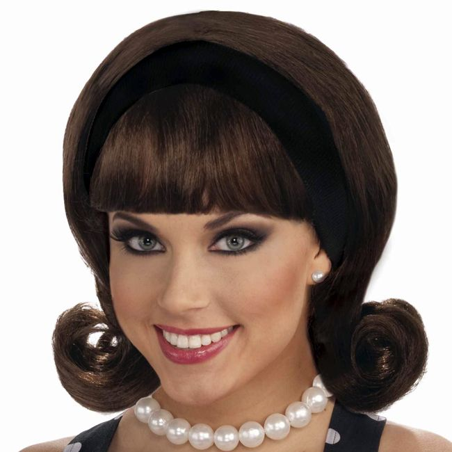 vintage hair- our 50s Brown Flip Headband Wig. During the 1950s era, the flip was hip! Our 50s Flip Headband Wig features synthetic brunette brown hair styled in a shoulder-length hairstyle slightly backcombed at the top and then curled out at the ends in roller fashion with full bangs. It comes complete with an attached black headband. The flip was another take on the bob in which the hair is curled outward. Just add in some polka dots and saddle ...
