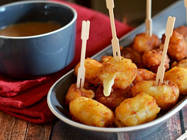There's a lot to love about poutine, the Canadian dish of brown gravy-  and cheese curd-topped fries. But it's not exactly a good finger food at  a party, unless you like the idea of dozens of gravy-coated fingers being wiped on the couch. Well, we'd like to introduce the solution to that problem: the Poutine Popper.