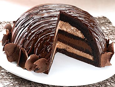 Dome Cake Thin layers of mud cake, filled with two layers of chocolate cream, moistened with raspberry syrup and chocolate mousse cream in a distinctive dome shape