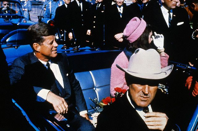22 Nov 1963, Dallas, Texas, USA --- President John Kennedy rides in a motorcade from the Dallas airport into the city with his wife Jacqueline and Texas Governor John Connally.