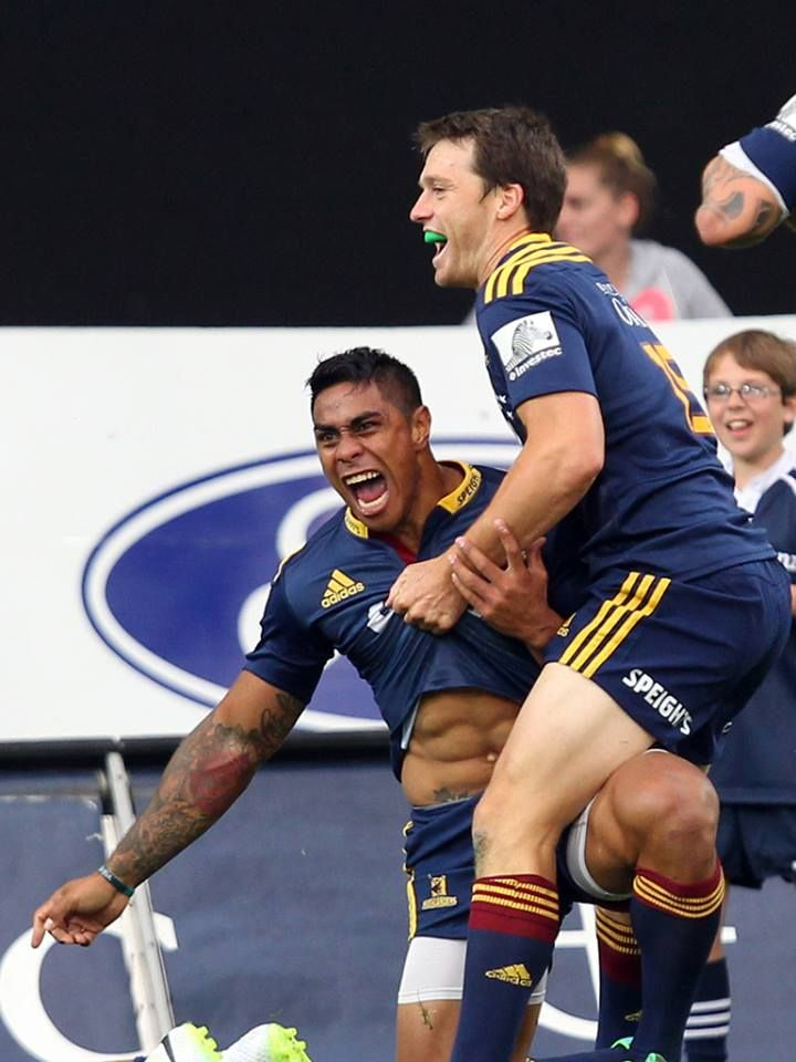 Malakai Fekitoa helped to his feet by Ben Smith after scoring a try for the Highlanders Superrugby 2014