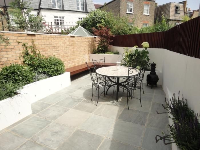 Kandla Grey Sandstone Paving in an urban garden. The riven surface adds texture, whilst the single sized paving modules create a more contemporary finish. The best of both worlds!