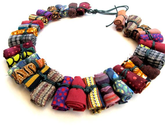 Daring tribal bib fiber necklace.