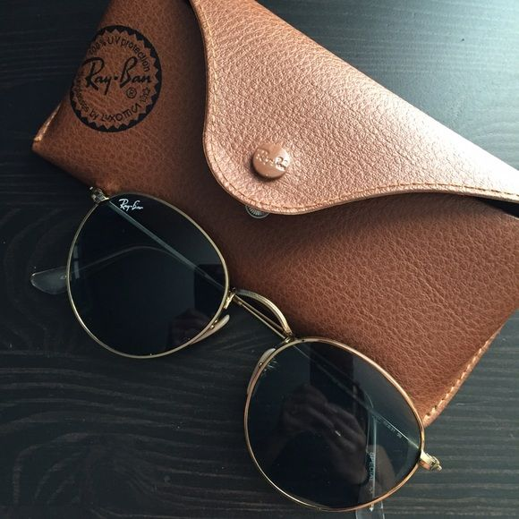 Ray Ban Round Metal Sunglasses Ray Bound Round sunglasses. Size 50. Some wear but in good condition. The Ray Ban logo on the front lens is a tiny bit worn off like shown in one of the photos above. Trendy pair of glasses. Authentic. Firm on price. Ray-Ban Accessories Sunglasses