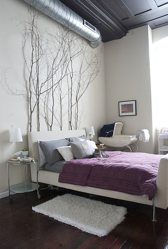 Purple loft bedroom with tree branches