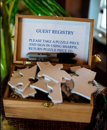 Puzzle piece guest book. Would be great to put a family photo or pic of loved one on the other side.