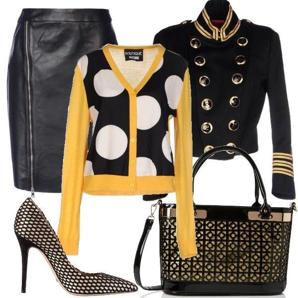 Abbigliamento trendy, elegante senza esagerazione. La giacca militare è indossata con una gonna pencil skirt e con un golfino a pois in pura lana. Le décolleté, beige e nere, con tacco a spillo sono abbinate alla borsa a mano con tracolla.