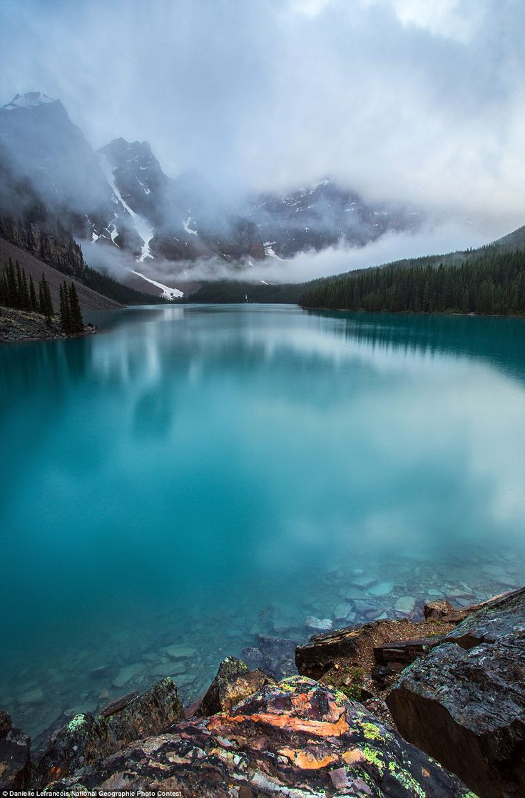2012 National Geographic Photography Contest: The beautifully moody summer rain clouds hover over one of Banff National Park's true gems, Moraine Lake in this image by Danielle Lefrancois: The National, Lakes Louis, Buckets Lists, Danielle Lefrancoi, National Geographic, Morain Lakes, Places, Photo, Banff National Parks