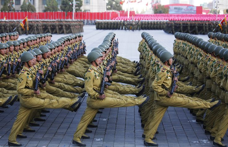 North Korean soldiers in historic uniforms march during a parade on Kim Il Sung Square on October 10, 2015.