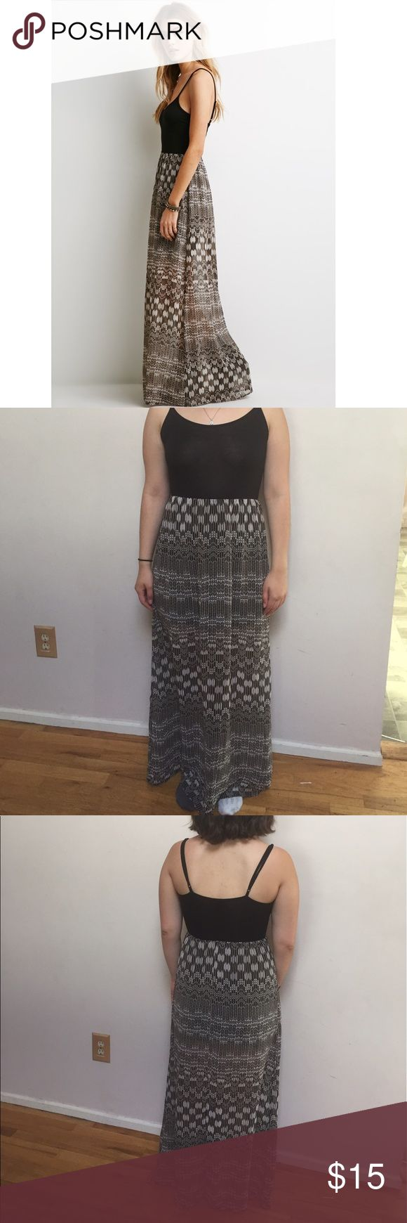 Tribal Maxi Dress Really adorable maxi dress with a black sleeveless top. The bottom is sheer with a black slip attached underneath. It's only been worn a few times. It's in perfect condition except for one pull in the sheer bottom (pictured above), but it is barely noticeable. Great for the summer with a pair of brown sandals. Forever 21 Dresses Maxi