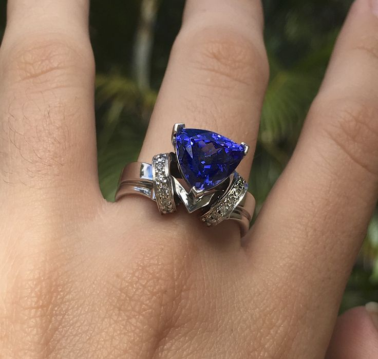 Tanzanite and Diamond hand crafted ring. #ring #jewellery #engagementring #tanzanite #trillionstone #ringonhand #blue #engagementring #love #couture #art #design