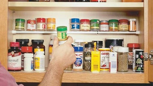 Use a tension rod to create a second shelf in your kitchen cabinet for spices.