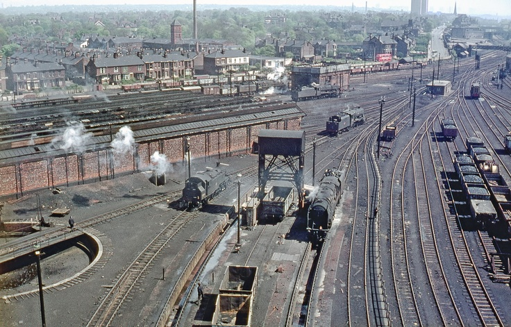 Patricroft MPD aerial view from the coaling tower. Two BR Standard '9F' 2-10-0s, two ex-LMS '8F' 2-8-0s and a BR Standard '2' class' 2-6-2 tank in view