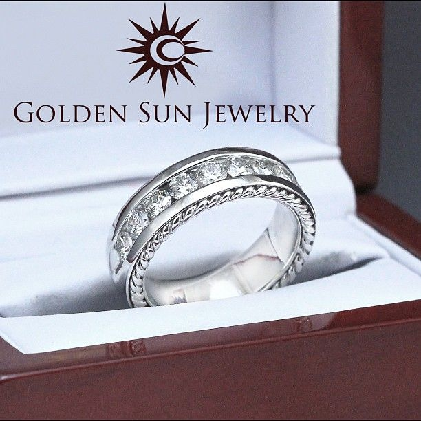 GOLDEN SUN JEWELRY: Men's diamond wedding band. Featuring channel set diamonds with accenting braids on the outer edge of the band. #gold #detroit #rock #diamonds #diamondring #ring #engagementring #hourdetroit #theknot #engagement #engaged #marriage #married #bride2bride #husband #band #groom #weddingring #weddingband