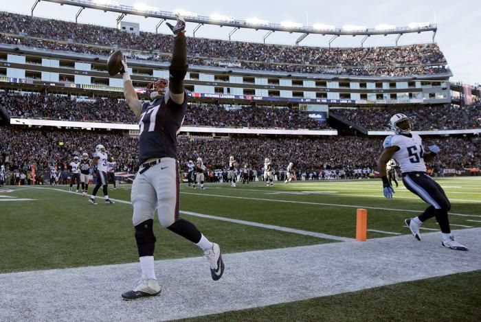 New England Patriots tight end Rob Gronkowski (87) celebrates his touchdown catch in front of Tennessee Titans linebacker Avery Williamson (54) in the first half of an NFL football game, Sunday, Dec. 20, 2015, in Foxborough, Mass. (AP Photo/Charles Krupa)