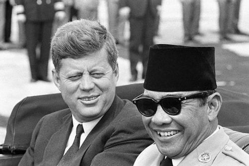 President Kenendy and Indonesian President Sukarno are shown in back of limousine following the latter's arrival here today. Sukarno is here for talks which may provide a gauge of U.S. prestige in the wake of the Cuban incident - Andrews AFB - April 1961