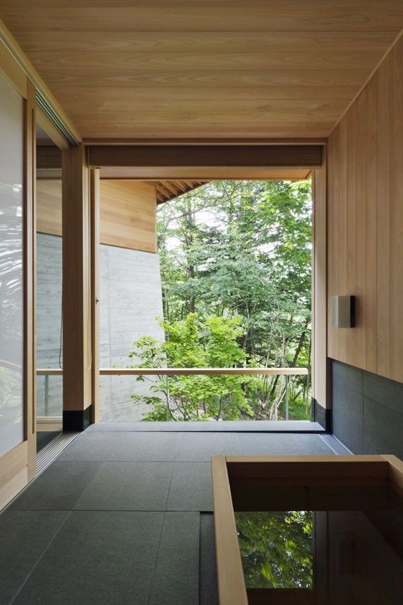 A wood soaking tub in a bath by Yasushi Horibe Architect + Associates in the resort town of Karuizawa. The glazing wall opens completely to the outdoors | Gardenista