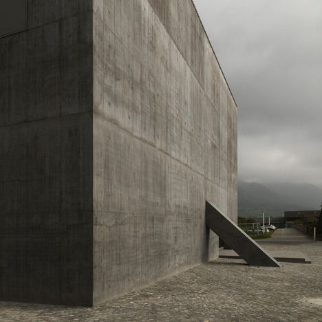 An auditorium behind sheer concrete walls