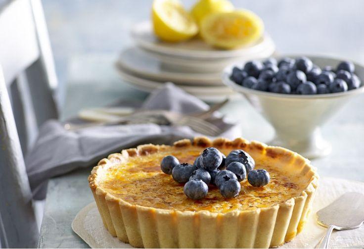 A crisp toffee shell tops this luscious lemon tart