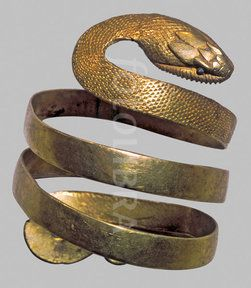 Roman Gold Snake Armband (A gold armband in the form of a snake from Pompeii. 1st Century Roman displayed in the Museo...)